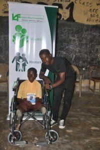 IAF beneficiary, Godknows Atata and IAF Education Ambassador, Vincent Adeoba at the wheelchair donation to Godknows Atata