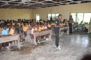 IAF Education Ambassador, Vincent Adeoba speaking to students at the Governmment Secondary School, Okarki, Rivers State