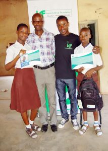 Student Beneficiaries of the IAF Scholarship, a teacher and the IAF Education Ambassador, Vincent Adeoba